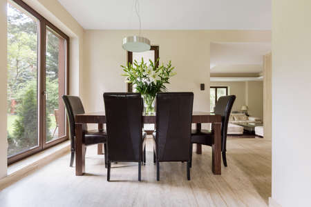 table and chairs: Bright dining space with wooden table, chairs and big window