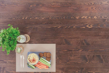 lunch tray: Tray with vegan food prepared for lunch on a wooden table