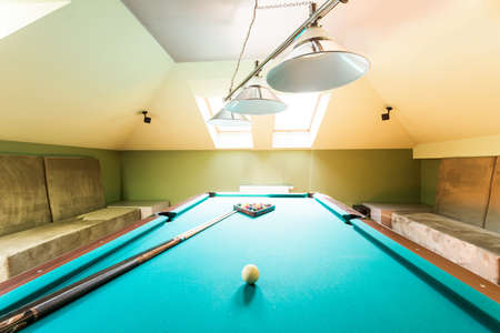 lightsome: Entertainment room in the house in the attic with a billiard table