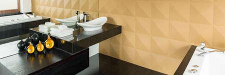 bathroom wall: Modern functional bathroom with beige wall and black floor Stock Photo