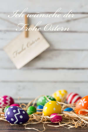 Colorful Easter eggs and Easter greetings in German