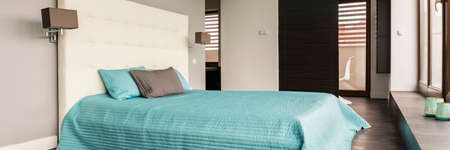 kingsize: Cozy modern bedroom with blue king-size bed