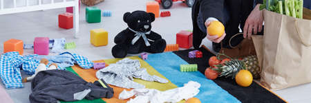 messy clothes: Room floor messy with childrens soft toys and clothes Stock Photo