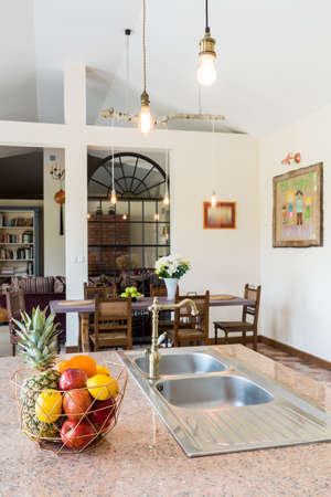 lightsome: View from kitchen on countertop and dining table with chairs