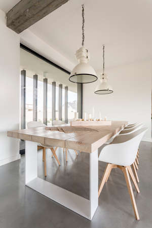 Cozy dining room with stylish table and chairs