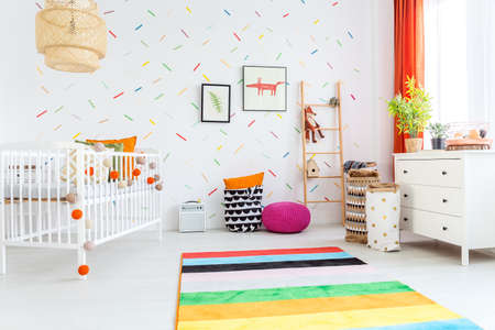Spacious white room with cradle designed for kids