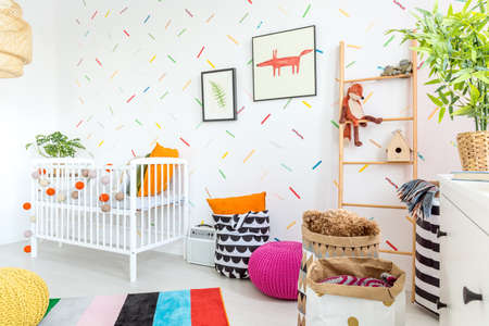Little baby interior deigned in scandinavian style with colorful accents