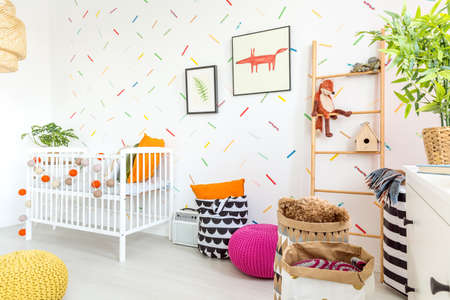 Cozy spacious baby room decorated in scandinavian style