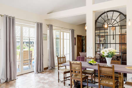 lightsome: Spacious and bright dinning area with large table opened to living room