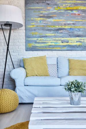 wall paintings: Modern and light living room with with many paintings on the wall Stock Photo