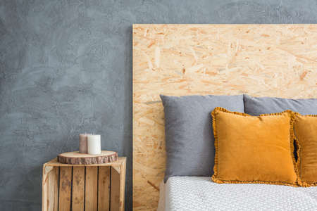Bedroom with eco bed with OSB headboard and crate nightstand Stock Photo
