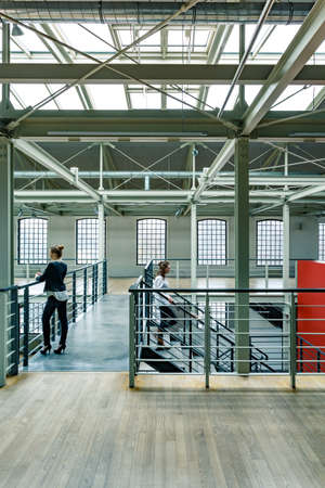 revitalization: Factory building with stairs, wood floor and loft windows