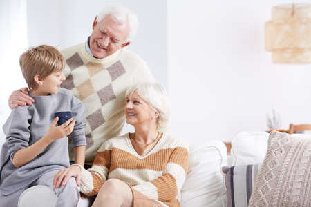 Grandson, grandma and grandpa spending time together Stock Photo
