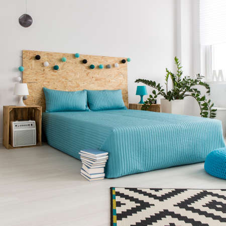 redecoration: Blue bedcover on the bed in modern minimalist bedroom with DIY hipster furnitures