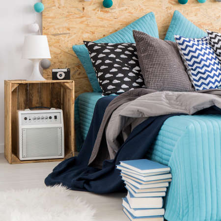 decoration messy: Blue and gray details in new modern bedroom with bed, pillows and hipster DIY nightstand