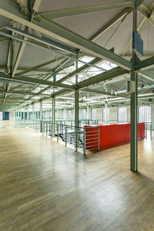 storey: Modern factory building with steel construction and wood floor
