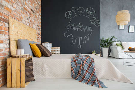 osb: Industrial style bedroom with brick wall open to living room Stock Photo