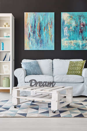 decoracion mesas: Modern room with navy walls and white furniture