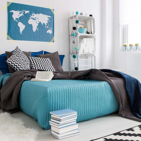 Modern cozy bedroom with double bed with blue bedding diy hipster modern cozy bedroom with double bed with blue bedding diy hipster bookcase and world map gumiabroncs Gallery
