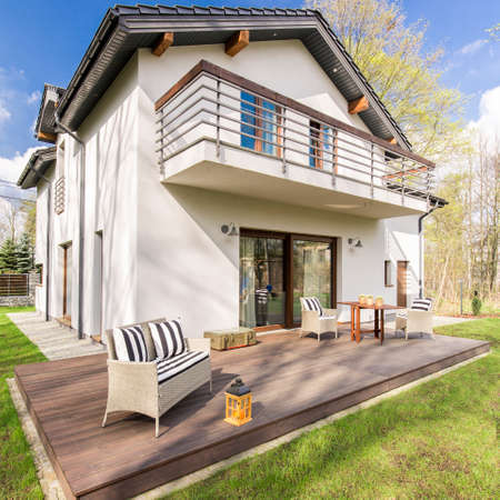 Big modern detached house with a wooden tarrace in the backyard