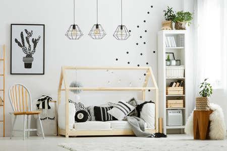 Baby bedroom in scandinavian style with wood chair and bed Banco de Imagens