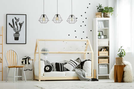 Baby bedroom in scandinavian style with wood chair and bed Stockfoto