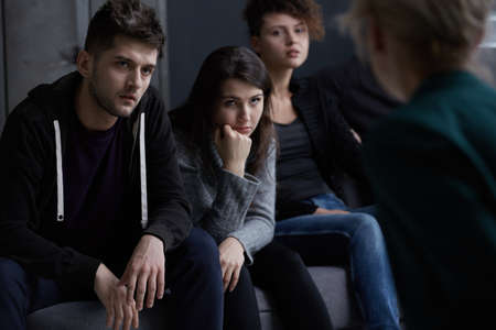 Young people addicted to drugs participating in group therapy