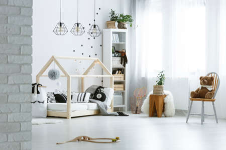 lamp house: Baby room with brick wall, bed, lamps, bookcase and chair