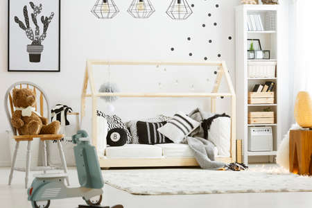 baby toys: Child bedroom with wood bed, rocking scooter, lamps and chair