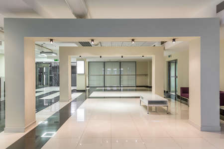 Clean and spacious minimalist hallway at modern medical university in bright tones