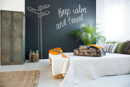 kingsize: King-size bed in cozy bedroom with chalkboard wall