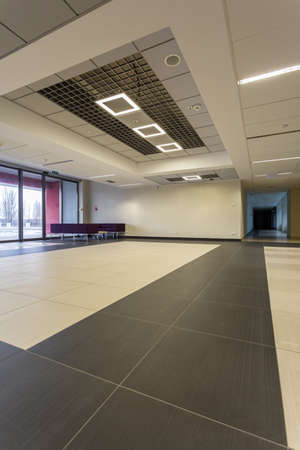 Empty spacious hall at modern university building in calm tones