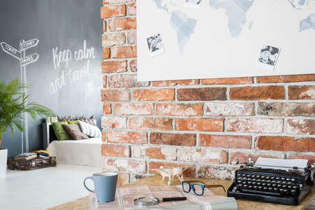 Modern loft with travel theme interior and brick wall