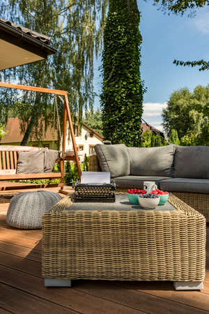 Stock Photo   Villa Patio With Modern Rattan Table, Sofa And Wooden Garden  Swing