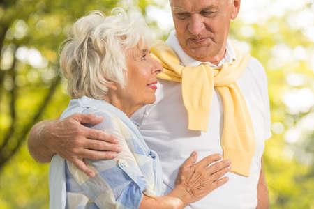 love park: Senior couple in love walking together in park