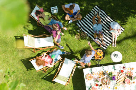Top view of friends having grill in garden