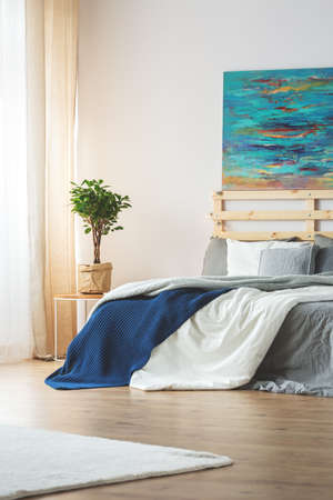 kingsize: Modern bedroom with blue painting above king-size bed