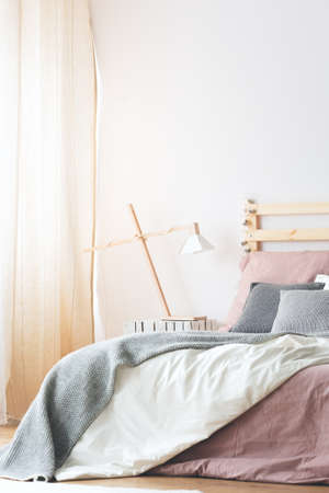 kingsize: King-size bed with pastel bedding in white modern bedroom