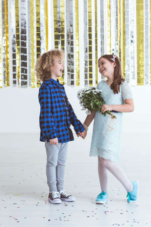carelessness: Small wooer and girl holding bouquet of flowers