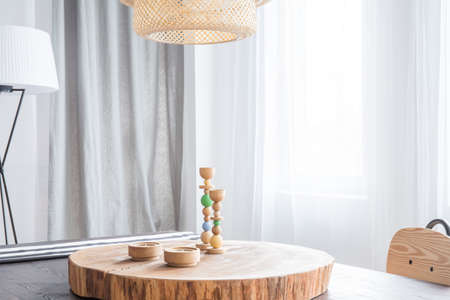 ceiling slab: Room with table, decorative round wooden desk and candlestick