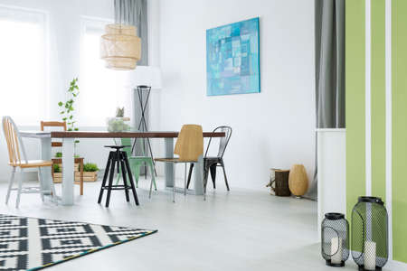 stool: Trendy flat with dining room, lamp, and decorative metal accessories
