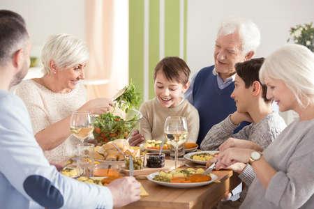 Happy big family eating festive dinner together