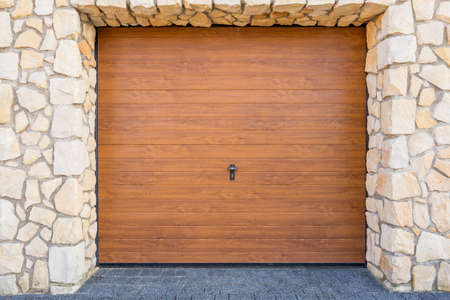 Brown and wooden door of a modern garage Imagens
