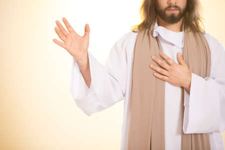Jesus holding one hand on heart and other one up Stock Photo