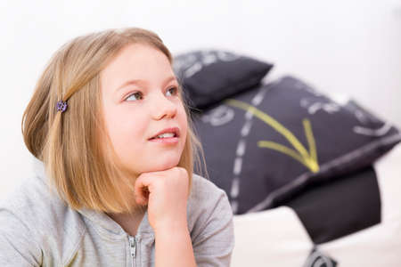 Portrait of little blond girl listening carefully