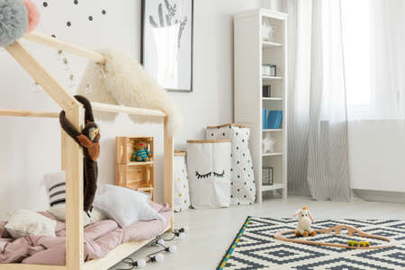 Modern black and white child room with bookcase and bed 版權商用圖片