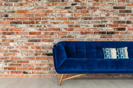 red sofa: Stylish industrial designed loft with blue comfortable couch Stock Photo