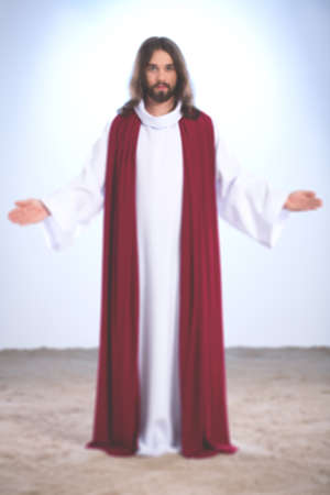 Personification of Jesus Christ standing with open arms, illuminated background