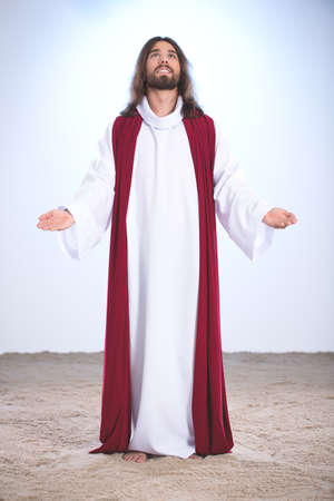 Jesus Christ praying to God, holding open arms