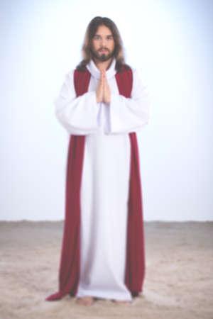 put together: Resurrected Jesus Christ praying with hands put together, amen gesture Stock Photo